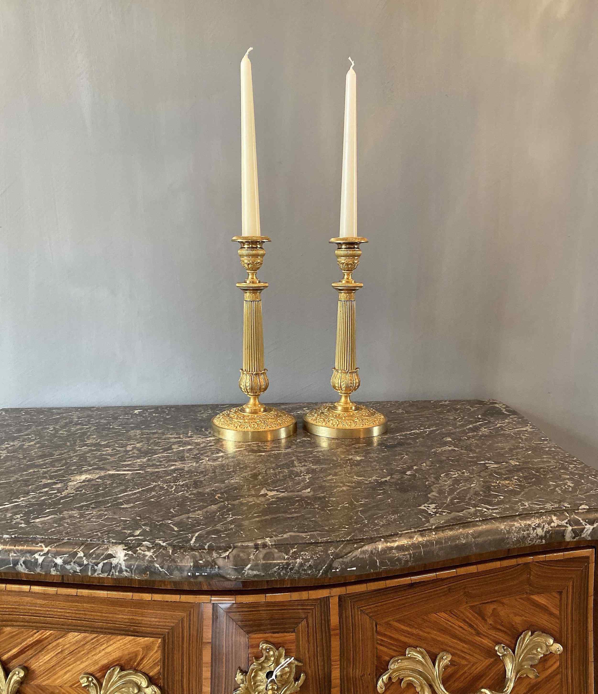 Una coppia del XIX sec. candelabri Impero bronzo dorato