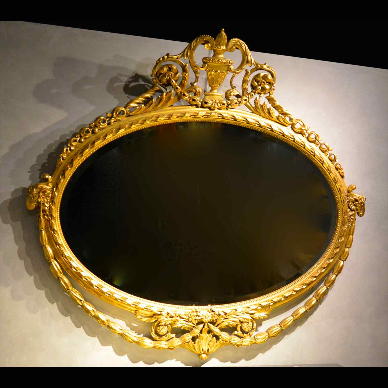 Ancient mirror in carved and gilded wood