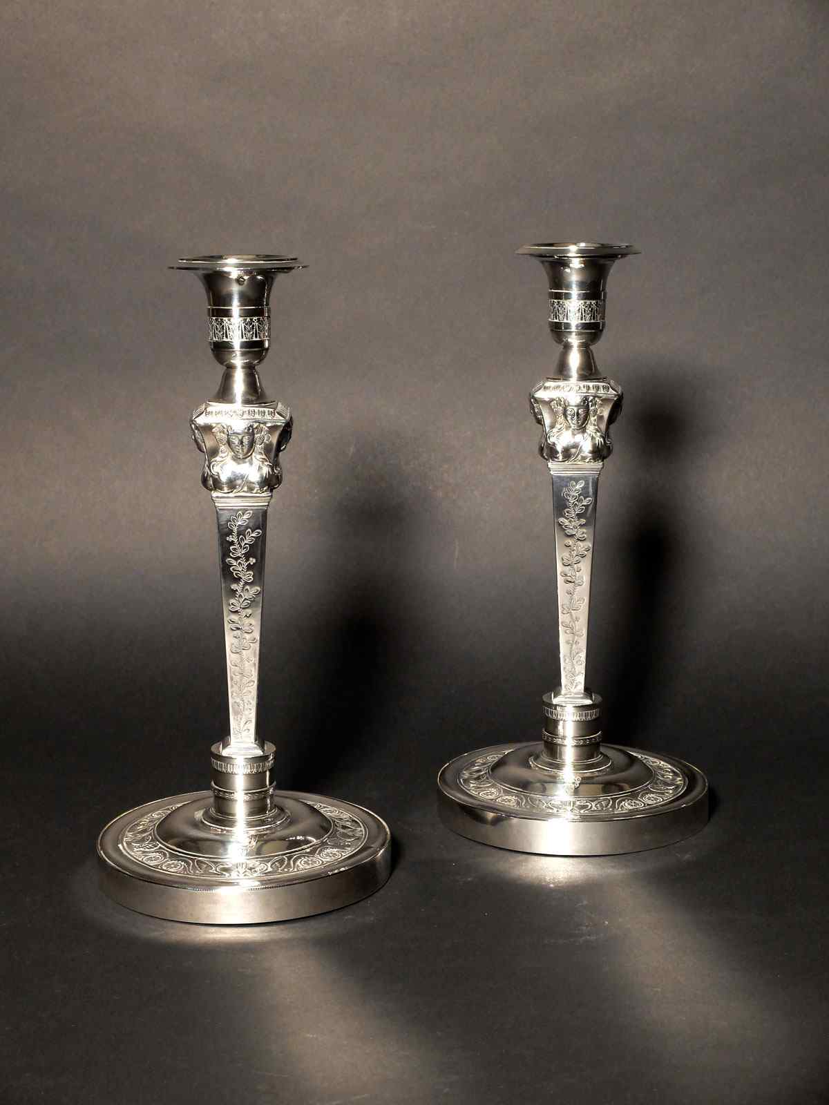 Pair of solid silver candlesticks, with the count's coat of