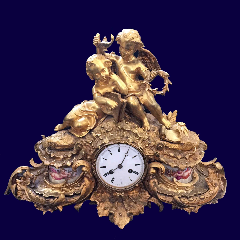 Orologio in bronzo dorato e porcellana di Sevres.