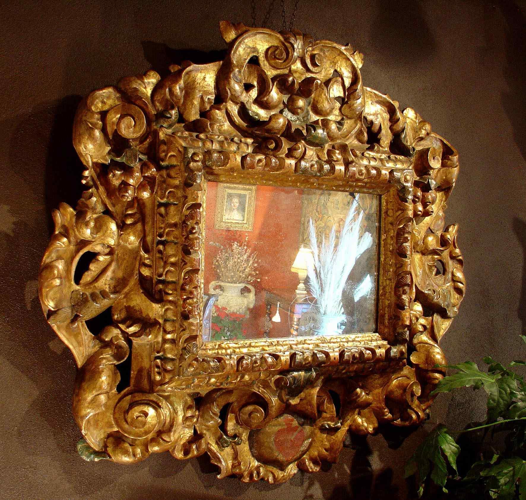 Importante specchiera in legno dorato - XVII secolo