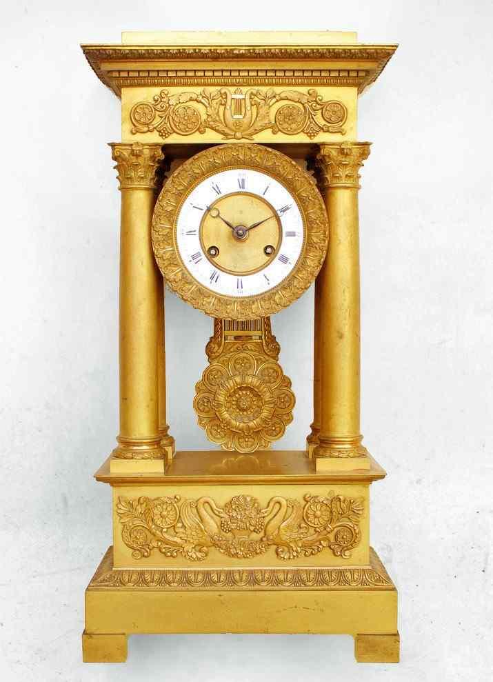 orologio impero in bronzo dorato