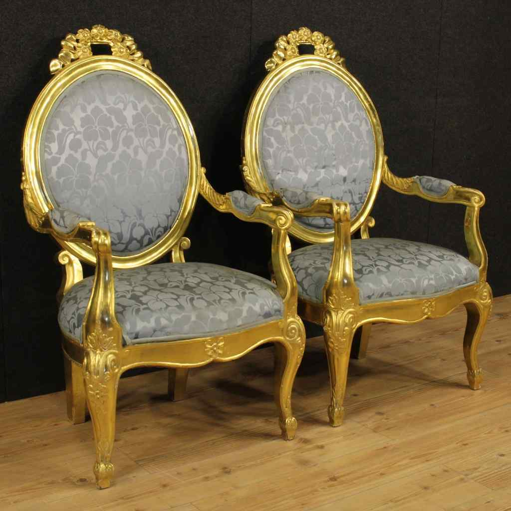 Pair of Italian gilded armchairs with floral fabric