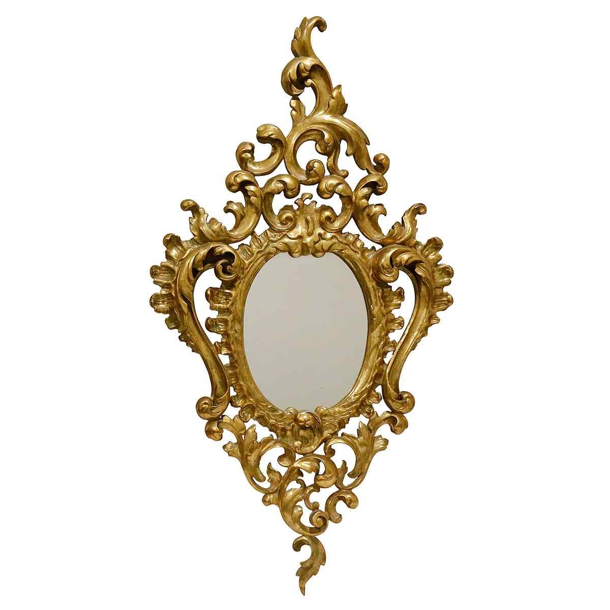 Uno specchio in legno dorato anni '40