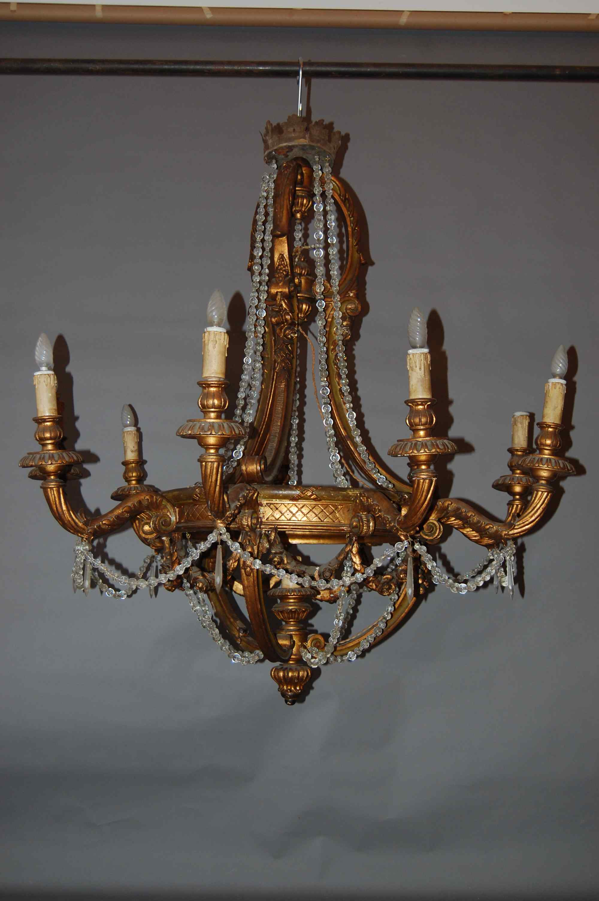 spectacular golden and carved wooden chandelier