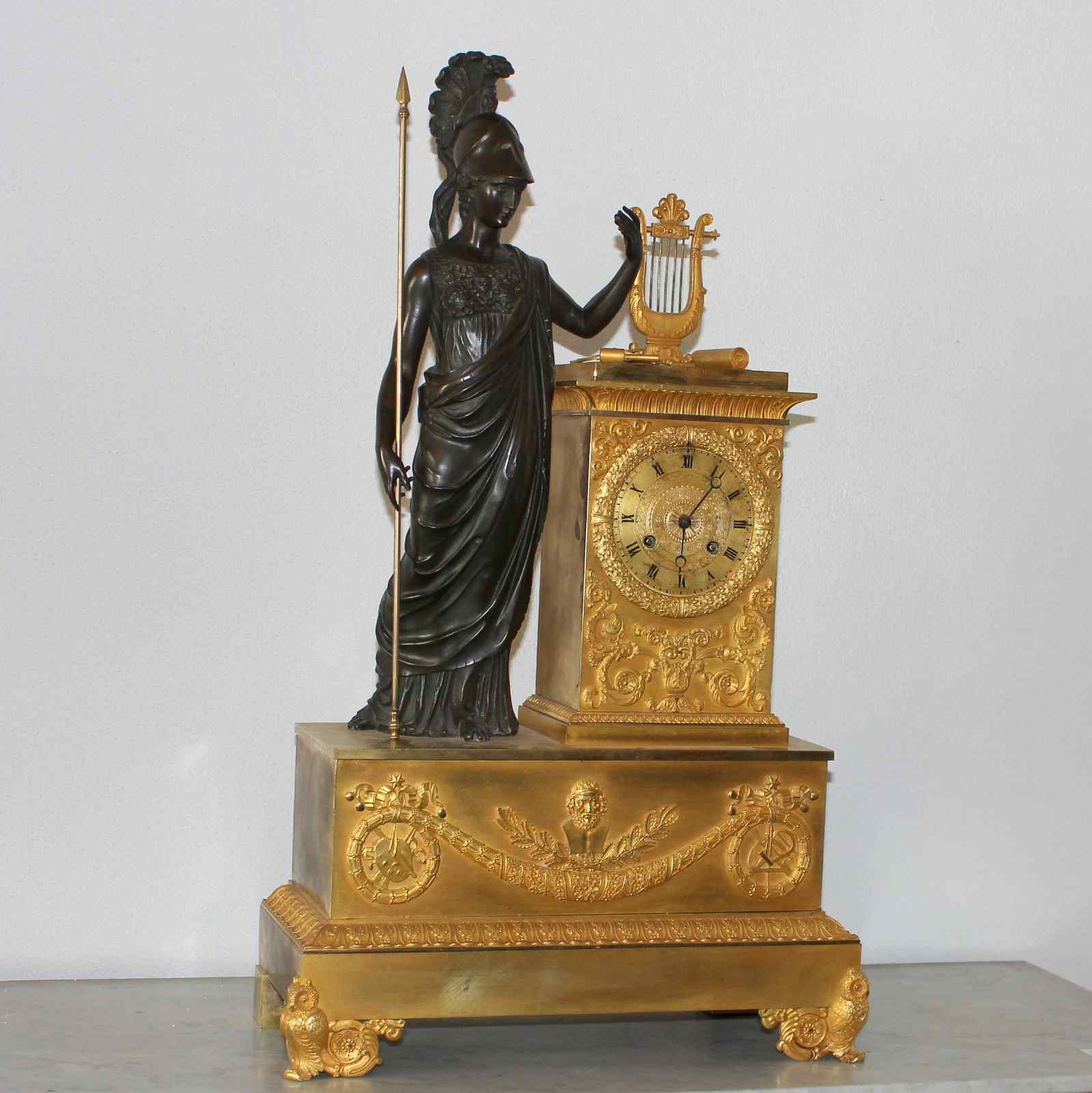 French antique clock in gilded bronze and brown bronze
