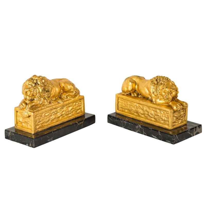 Pair of golden bronze lions. End of the 19th century